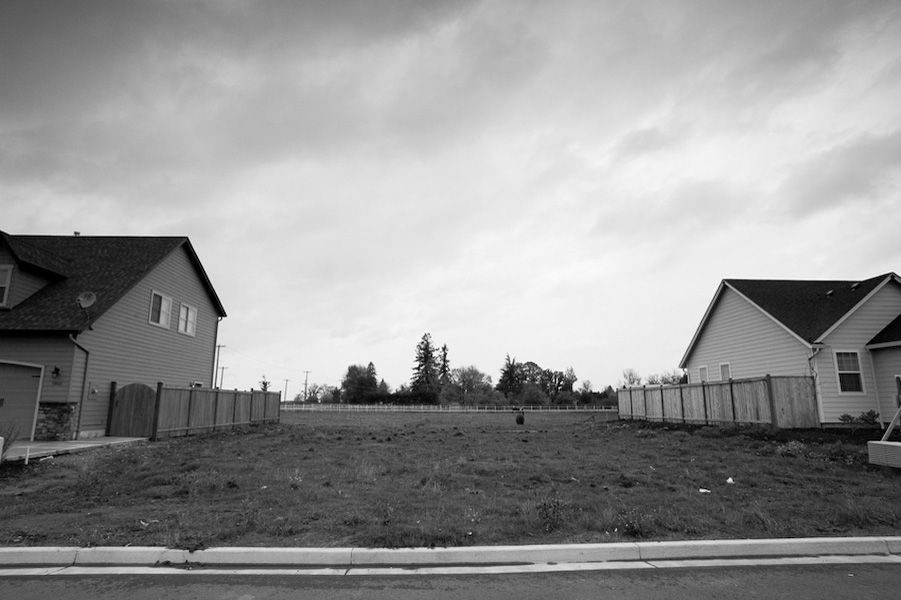 In some housing developments in Junction City, properties sit empty; waiting for a house to be built on their land. Owners of lots have had to back-out of the construction of new homes due to the rising cost. Consequently, lots like this one seem out of place with their surroundings.