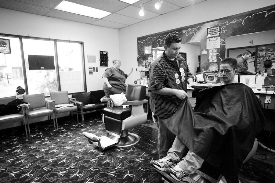 Owners Cassandra Reade and brother Talon Wood wrap up a haircut for Jim Hagler, a customer of the Junction City Barber Shop for 6 years. Much like many small shops in JC (including the recently closed Gibson Motor Company), this one has been passed down from generation to generation.