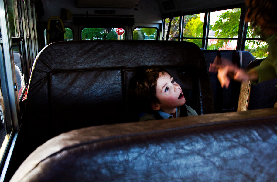 """""""I love you,"""" B's mother signs to him after buckling him into the school bus."""