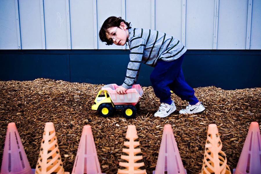 B entertains himself on the playground at the Vivian Olum Child Development Center.