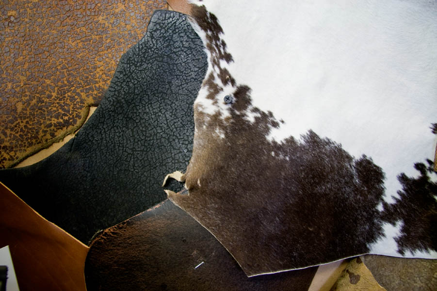 Leather samples haphazardly cover a wall at Bill Adler Design, based in Eugene, OR.