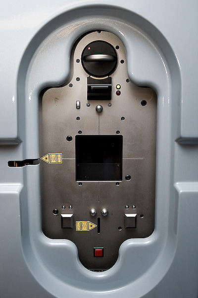 A panel on the Linear Accelerator used for imaging. The radiation comes through the black square and makes contact with a phosphorous plate to capture an image.
