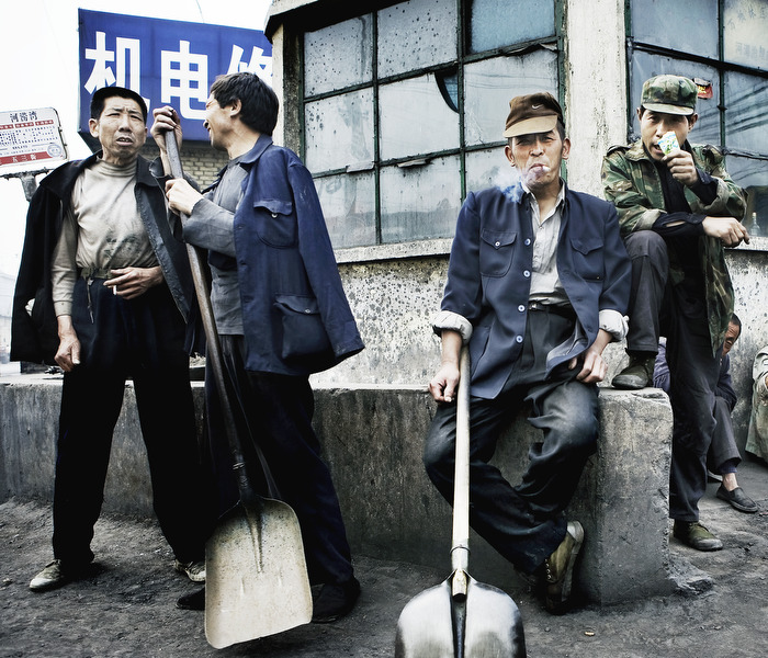Coal workers waiting for a job in downtown Taiyuan.